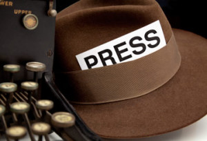 journalist hat and typewriter